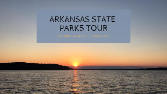 "Sunset on DeGray Lake with text ""Arkansas State Parks Tour: Adventure Awaits in the Natural State"""
